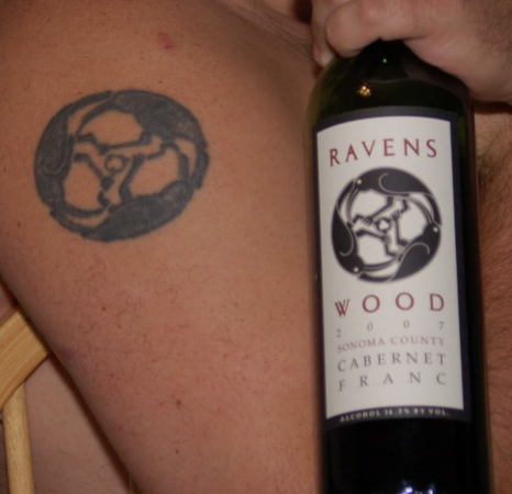 Ravenswood tattoo on arm