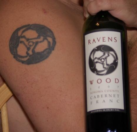 Ravenswood tattoo on arm